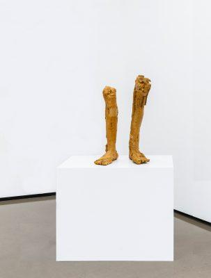 two feet on a plinth
