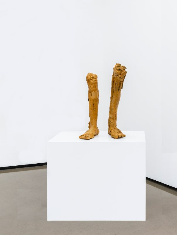 two feet on a plinth