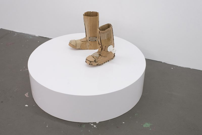 Two boots on a plinth