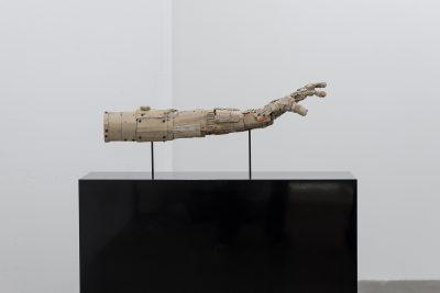 Armsculpture on a plinth