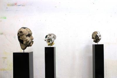 Three head on a plinth