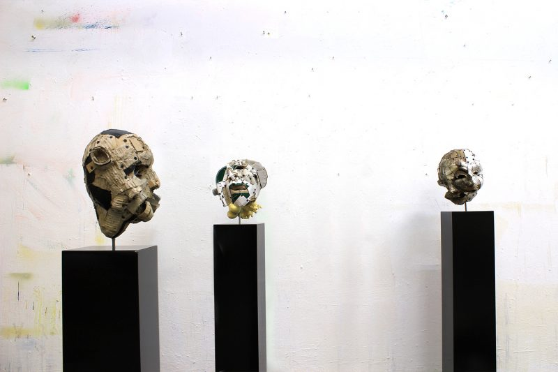 Three head on a plinth