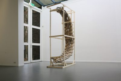 Caged ripped car tire sculpture