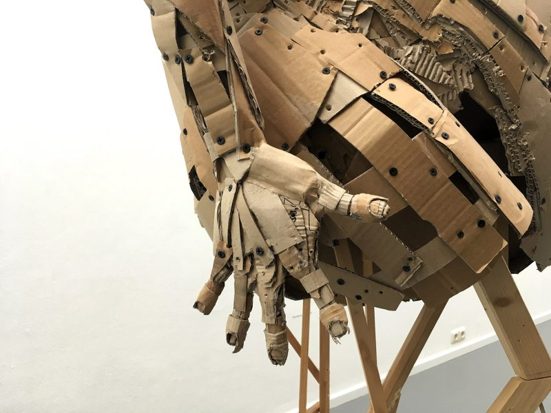 Cardboard - sculpture - close up - Hand