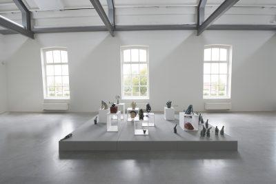 Exhibition shot of the ceramic installation Noah's Arc